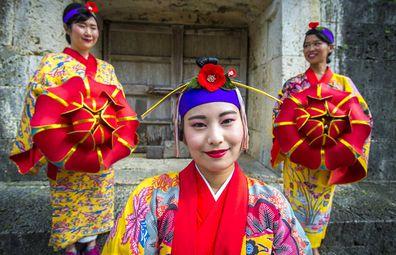 Women in traditional Okinawa dress.