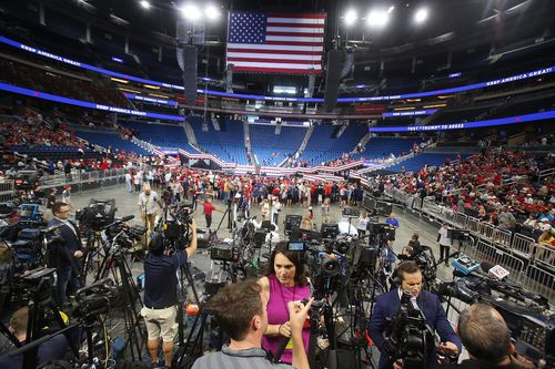 Trump supporters begin to take their seats inside the Amway Centre before the President Trump campaign rally in downtown Orlando.