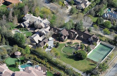 The aerial view of <b>Britney Spears</b>' home in the private community of 'Hidden Hills' is pretty freakin' impressive. Brit Brit's mansion is a cool 20 000 square feet on a three acre lot. It's got a pool, tennis courts and of course, a lovely welcoming pond in the front yard. Not sure if Britney's has enough room inside, though. The house <i>only</i> has ten bedrooms and thirteen bathrooms. Her kids could have like 8 friends stay over at once, all in separate digs! There's also a games room, which we're betting is packed with the latest and best in all things kiddie.