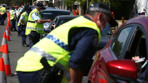 NSW police patrol a coronavirus checkpoint.