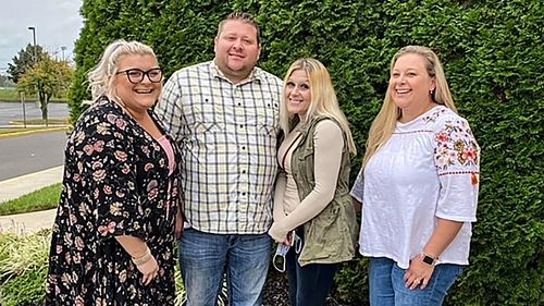 Jennifer Lannon, second from right, poses for a photo with her brother Chris Whitman, second from left, and sisters, Sarah Whitman, far left, and Kim Bermudez in Blackwood, New Jersey. Ms Lannon's body and three other people were found in a vehicle in a parking garage at Albuquerque International Sunport, New Mexico's largest airport, on March 5. Her ex-husband, Sean Lannon, said he confessed to 16 killings in all, including the four found at the airport.