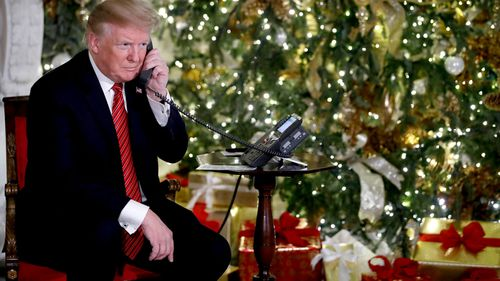'Well, you just enjoy yourself,' US President Donald Trump told a seven-year-old boy during one of his Santa Tracker phone calls.