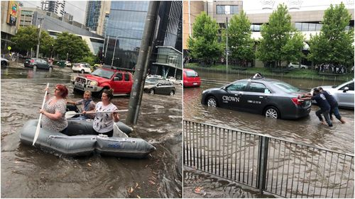 Some women took an inflatable raft for a paddle in the CBD, while a pair of men helped stranded cab driver.