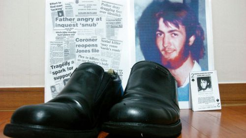 Newspaper clippings about backpacker Anthony Jones who went missing in Queensland 28 years ago, alongside an old pair of shoes. (60 Minutes)