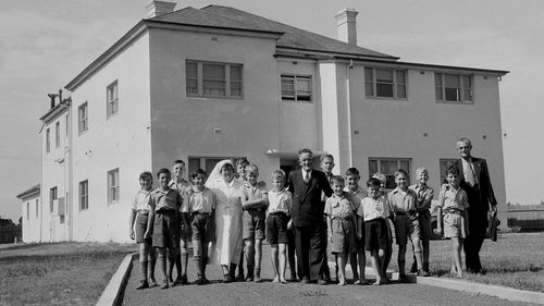 In this 1953 black and white photo released by the National Archives of Australia shown are British orphans posing for a photo at Melrose House, near Parramatta, Australia. Prime Minister Kevin Rudd issued a historic apology Monday, Nov. 16, 2009, to thousands of impoverished British children shipped to Australia