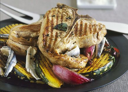Marinated veal T-bone steaks with grilled pumpkin and anchovies