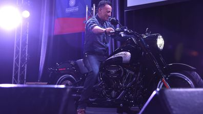 Bruce Springsteen arrives on stage on a motorcycle as The New York Comedy Festival and The Bob Woodruff Foundation present the 10th Annual Stand Up for Heroes event at The Theater at Madison Square Garden on November 1, 2016 in New York City.