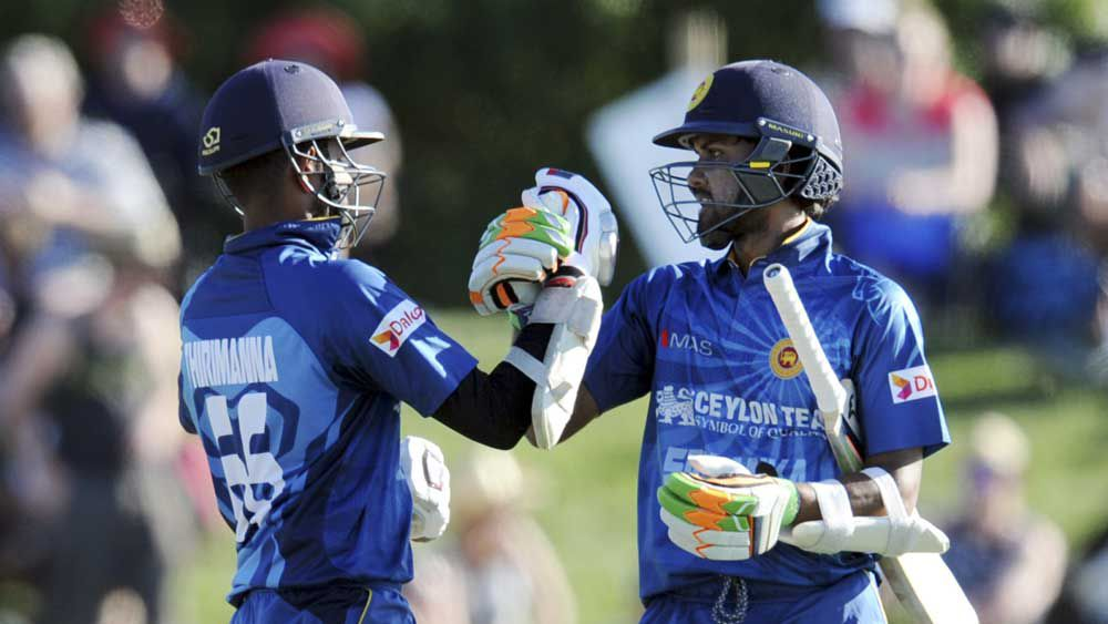 Sri Lanka's openers set up an eight wicket win. (AAP)