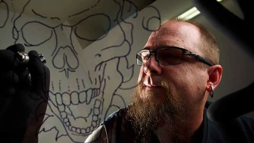 Artist Zach Tait, works on a tattoo at the Wicked Ink Tattoo and Body Piercing studio in Penrith.