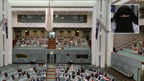 Women in burqas will no longer be required to sit behind protective glass while attending parliament. (AAP)