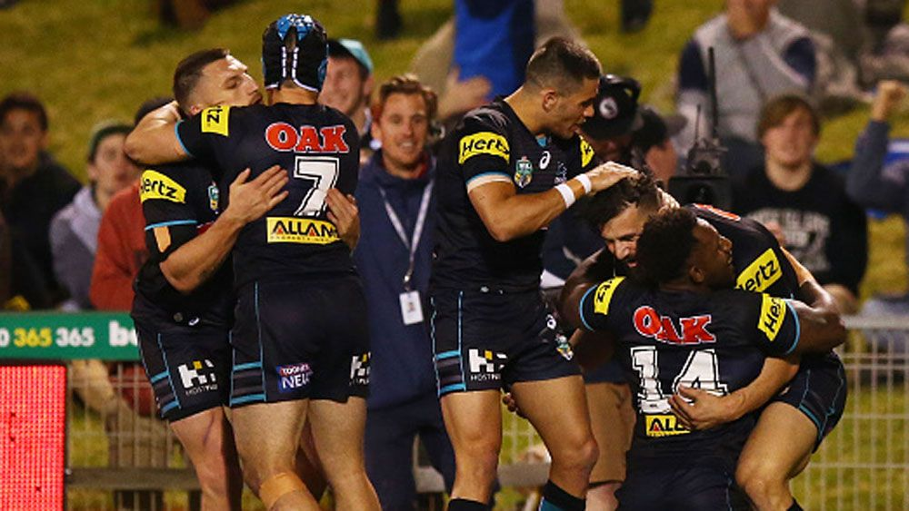 Panthers players celebrate a try in 2015. (Getty)