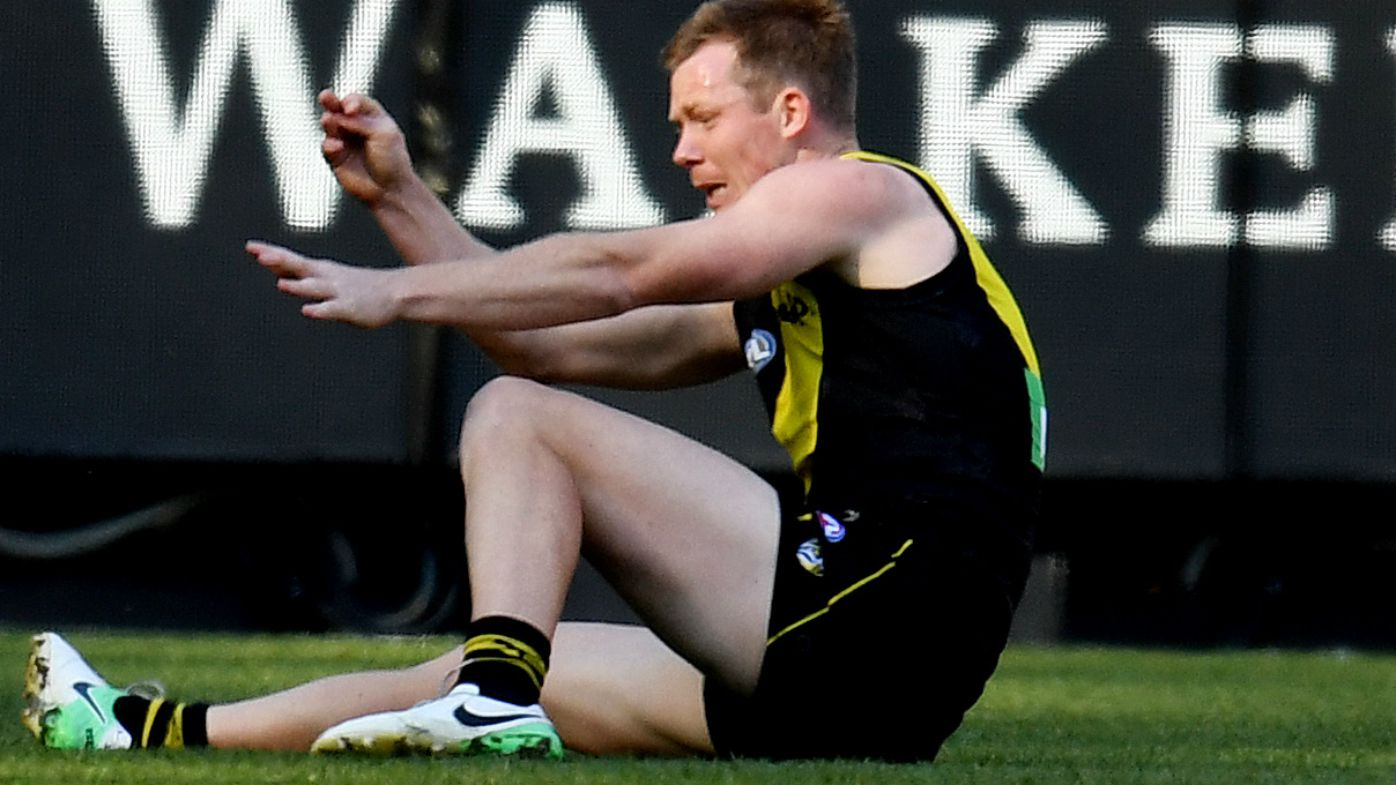 Jack Riewoldt concussed as Richmond holds off plucky St Kilda