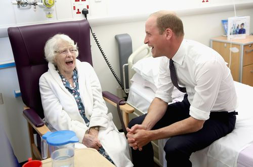 The Duke of Cambridge shares a joke with patient Theresa Jones in the frailty unit during his visit to Aintree University Hospital. (AAP)
