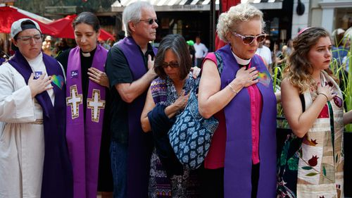 Mourners gather outside the memorial service for Heather Heyer. (AAP)