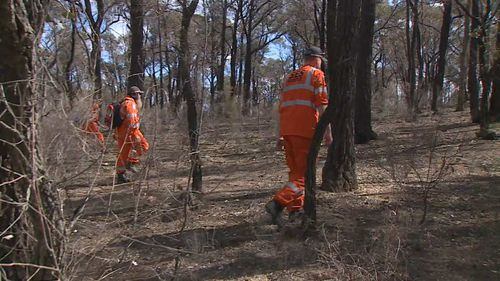 Police and SES scoured bushland for the Melbourne woman's body yesterday. (9NEWS)