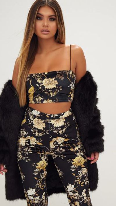 "<a href=""https://www.prettylittlething.com.au/black-floral-velvet-strappy-crop-top.html"" target=""_blank"" draggable=""false"">Black floral velvet strappy crop top, $18.</a>"