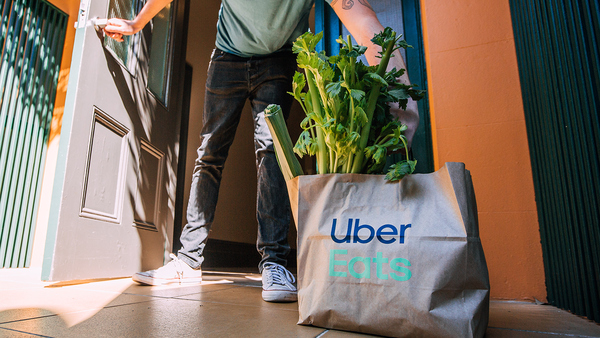 Uber Eats home delivers Woolworths groceries