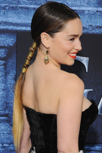 Hairstylist Adir Abergel created a long, ombre pony on Emilia Clarke, complete with coiled gold detailing fit for a warrior princess.