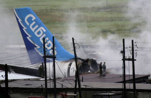 The wreckage of an Airbus A-310 plane sits smoldering after crashing in the Siberian city of Irkutsk, Russia, in this July 9, 2006,file photo, with the logo of the Sibir airline on the wreckage. The Russian passenger plane burst into flames after it crashed on landing in the Siberian city of Irkutsk. (AP Photo/FILE)
