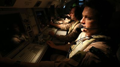 Pete Gillam, a surveillance and control officer on an E-7a Wedgetail aircraft, preparing for a mission. (Picture: ADF)