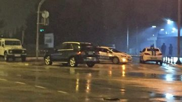 Police cars block the street where the US Embassy in Montenegro is located on. (Twitter/MundoEConflicto)