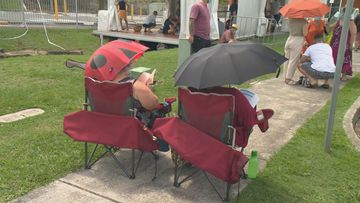 Some came ready for the wait with camp chairs and umbrellas.