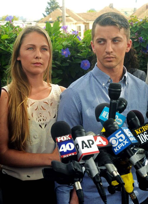 Denise Huskins and her boyfriend Aaron Quinn listen as their attorneys speak at a news conference in Vallejo, California in July 13, 2015. (AP)