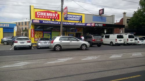 The source said the crowd steadily increased outside Chemist Warehouse in Essendon this morning. (Supplied)
