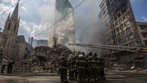 Chunks of fiery debris were sent crashing into neighbouring buildings and surrounding streets after the dramatic collapse after the fire in Sao Paolo.