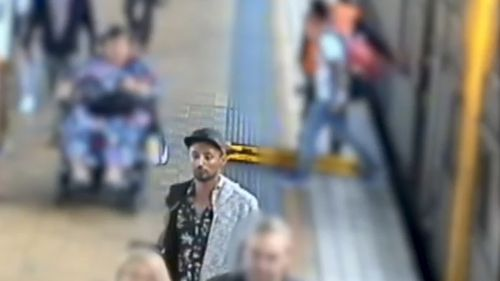 The man is described as tanned complexion with a thin build and tattoos on his arms.