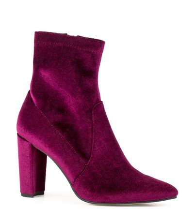 "<a href=""https://www.edwardmeller.com.au/zuriel-7692.html"" target=""_blank"" draggable=""false"">Edward Meller Zuriel Stretch Sock Boot in Bordeaux Velvet, $147</a>"