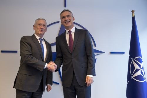 US Secretary for Defence Jim Mattis, left, shakes hands with NATO's Secretary General Jens Stoltenberg at a NATO meeting in Belgium yesterday.