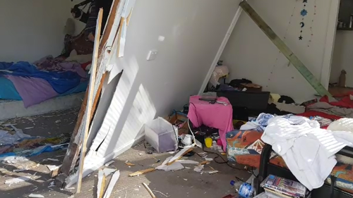 The full force of the car left significant damage to the weatherboard home. (9NEWS)