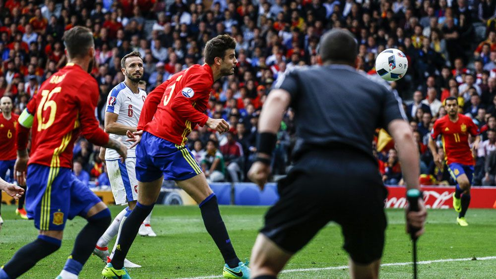 Spain relieved after sealing late win