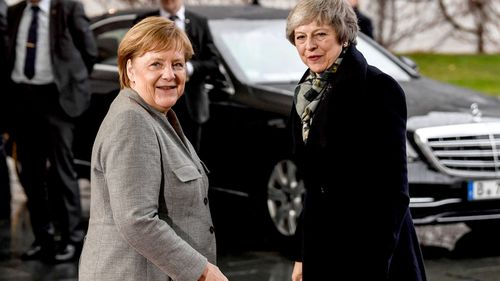 German Chancellor Angela Merkel welcomes British Prime Minister Theresa May at the Chancellery in Berlin, Germany.