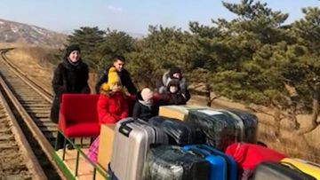 Unable to get out of North Korea any other way, this Russian family resorted to a hand-powered railway trolley.