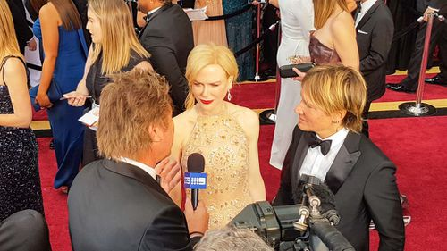 Best Supporting Actress and Lion star Nicole Kidman with husband Keith Urban. (9NEWS/Ehsan Knopf)