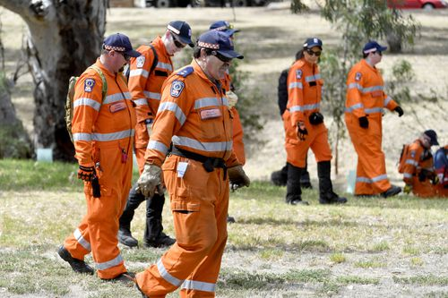 SES workers are assisting police with their search around the dense scrub near the Christie Creek catchment in Morphett Vale.