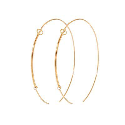 "<a href=""https://www.sarahandsebastian.com/collections/women/products/foam-hoop-gold"" target=""_blank"">Hoops, $1600, Sarah and Sebastian</a>"