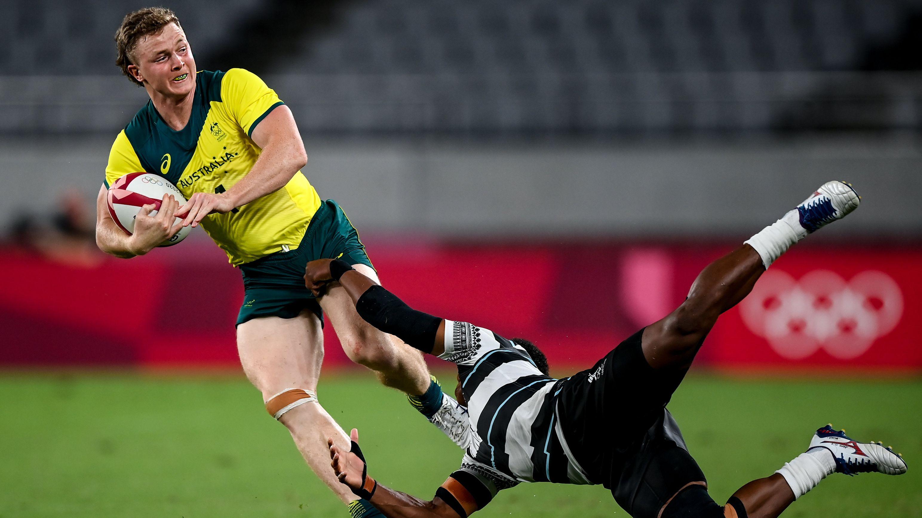 Australia's Henry Hutchinson is tackled by Fiji's Bolaca Napolioni.