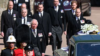 WINDSOR, ENGLAND - APRIL 17: Prince Charles, Prince of Wales walks behind The Duke of Edinburghs coffin, covered with His Royal Highnesss Personal Standard, during the Ceremonial Procession during the funeral of Prince Philip, Duke of Edinburgh at Windsor Castle on April 17, 2021 in Windsor, England. Prince Philip of Greece and Denmark was born 10 June 1921, in Greece. He served in the British Royal Navy and fought in WWII. He married the then Princess Elizabeth on 20 November 1947 and was creat