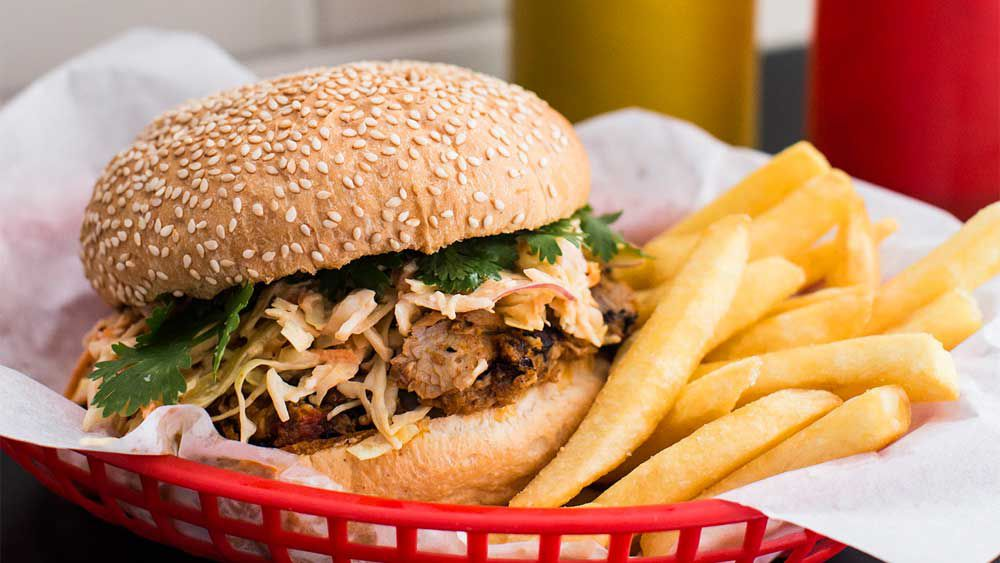Pulled pork burger with apple slaw and Russian dressing. Image: Southern Highlands Cookbook