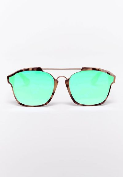 "<a href=""http://www.tuchuzy.com/accessories/sunglasses/abstract-green-dior"" target=""_blank"">Sunglasses, $650, Christian Dior, Tuchuzy</a>"