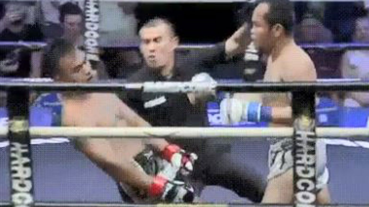 Muay Thai referee catches fighters head on way down after brutal knockout