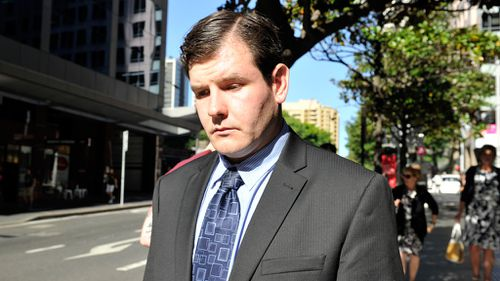 Investment banker James Ian Longworth leaving Downing Centre Court in Sydney. (AAP)