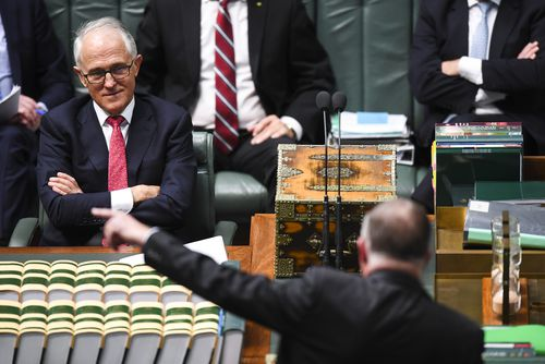 Prime Minister Malcolm Turnbull reacts as he listens to Shadow Infrastructure Minister Anthony Albanese during House of Representatives Question Time at Parliament House