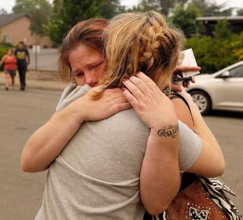"""My babies are dead,"" Sherry Bledsoe said through tears after she and family members met yesterday with sheriff's deputies. Picture: AP"