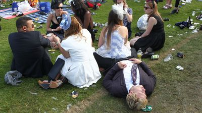 Punters enjoy the end of the day at Flemington Racecourse. (Photo: AAP Image/David Crosling)