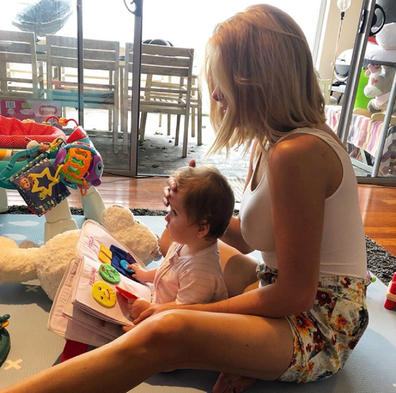 Erin reading a book with Eliza