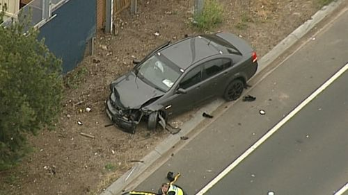 The driver sped off from police after colliding with a fence exiting the freeway.